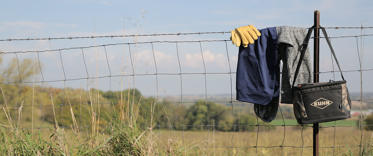 KUHN Gifts & Gear hanging on a fence.